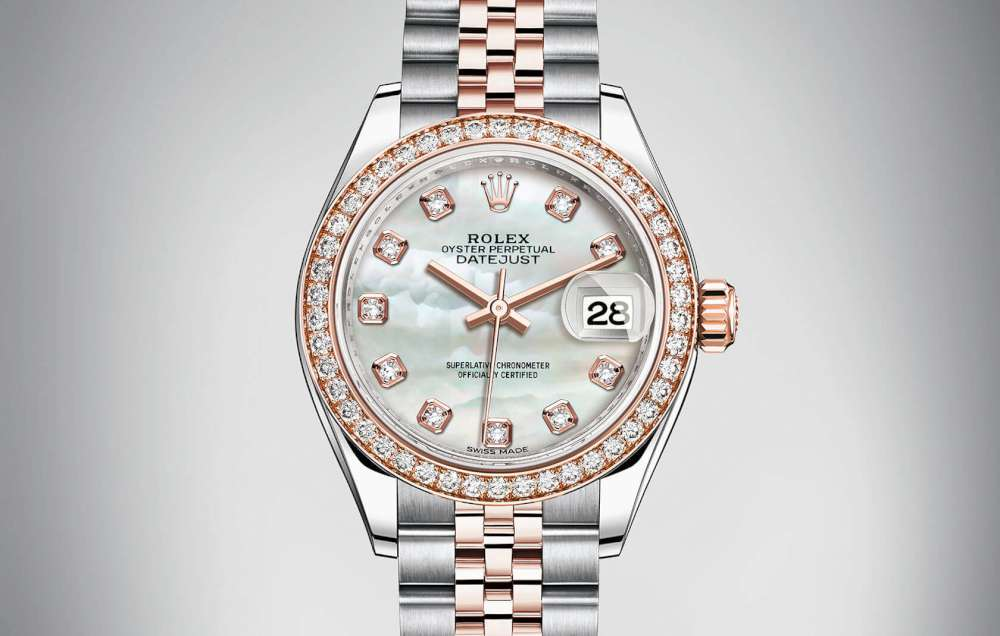 The 28 mm replica watches have white mother-of-pearl dials.