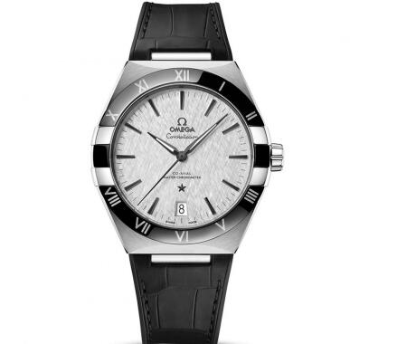 The dark gray hands and hour markers are striking on the light gray dial.